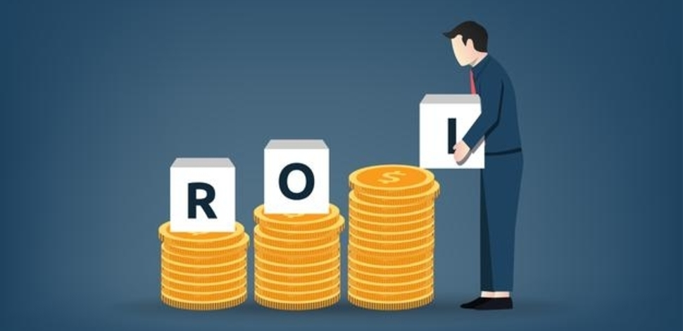 man stacking roi letters on towers of money