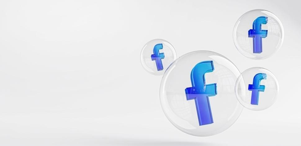 ikonki Facebooka wewnątrz szklanych baniek